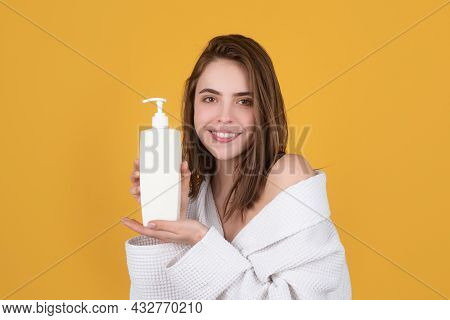 Woman Hold Bottle Shampoo And Conditioner. Young Brunette Woman With Nourished Long Hair, Studio Sho