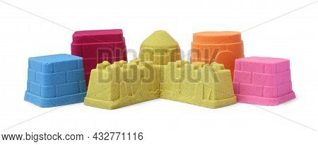 Different Towers Made Of Kinetic Sand On White Background