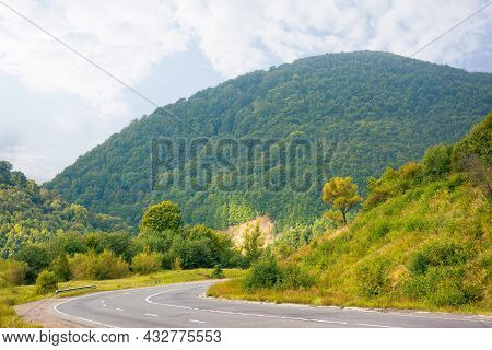 Mountain Road Through Countryside On A Cloudy Morning. Beautiful Landscape In September