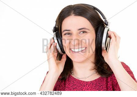 Young Smiling Happy Woman With Headphones Listen Sing Music Singing Aside Copy Space