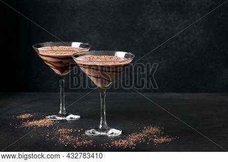 Chocolate Truffle Martini Cocktail On Black Background, Copy Space. Mudslide Truffletini Cocktail Re
