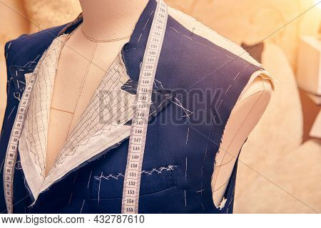 Semi-ready Jacket On Mannequin With Measuring Tape Across Neck. Suit Tailoring In Process Of Custom-