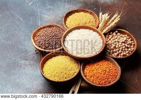 Gluten free cereals. Rice, buckwheat, corn groats, quinoa and millet in wooden bowls