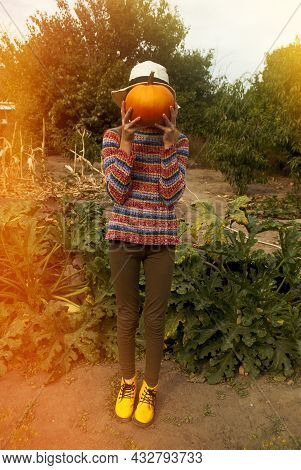 Portrait Of A Little Girl With A Pumpkin Instead Of A Head. Autumn Image.