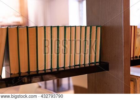 Old Vintage Books Standing In A Row.collection Of Vintage Book On Blurred Background. Copy Space.no