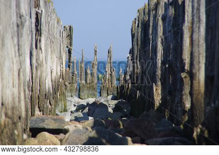 Old Wooden Breakwater By The Sea - Rusty Water Coastal Protection