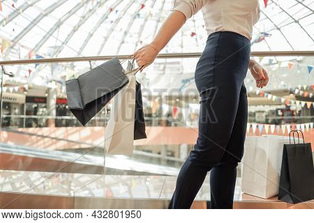 Woman With Shopping Bags In Mall. Without Head.