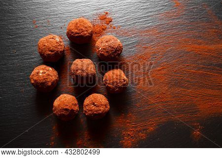 Chocolate Homemade Candy Truffles Laying On The Slate Background. Homemade Cooking Background With C