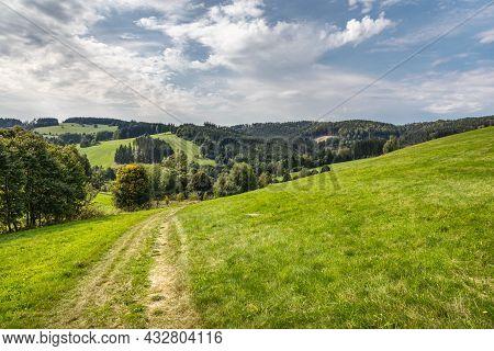 Dirt Road Through Summer Landscape Under Blue Cloudy Sky - Czech Republic, Europe.
