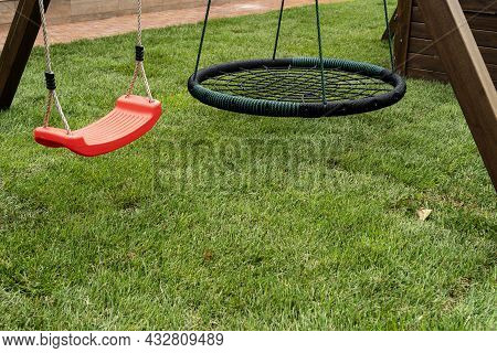 A Children's Playground In The Park, Children's Playground For Games, Two Empty Swings In Playground