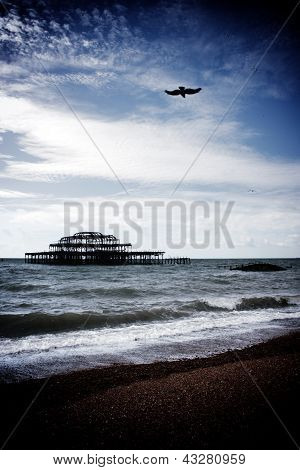 Remains Of Old West Pier Destroyed By Fire With Dark Stormclouds Above, Brighton, England, Uk