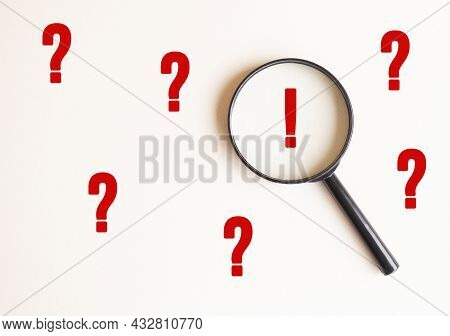 A Magnifying Glass On A Pale Beige Background With An Exclamation Mark. Magnifier With Exclamation M