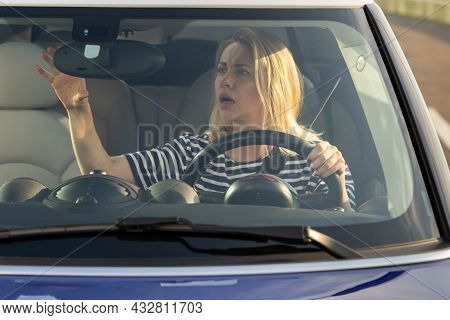 Shocked Woman Driver Look In Back View Mirror After Small Accident Car Crash On Road. Middle Aged Fe
