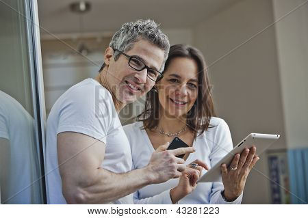 Portrait Of A Couple Smiling At Home