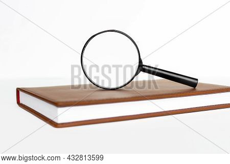 Magnifier On White Background With Place For Text. Magnifier On Notepad