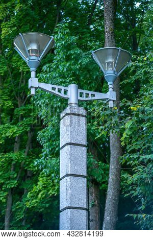 Street Lamp In The Park Against The Background Of Green Trees, Modern Street Lamp, Expensive Marble