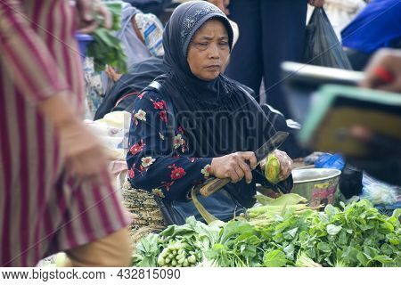 Portrait Of An Indonesian Woman Who Is Selling Vegetables. Location : Wonosobo, Central Java, Indone