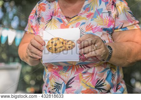 Woman Demonstrates Cards With Cookie Of The English Word And Pronounce Sounds And Words.