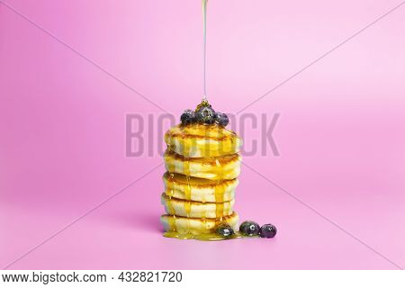 Pancakes With Berries On A Pink Banner Background. Lush Delicious Pancakes With Blueberries And Syru