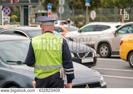 Moscow - September 12, 2020: Traffic police officer works on major street in a big city, day time