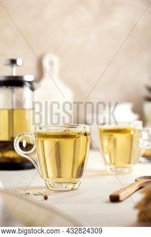 Herbal Tea Glass Cups And Teapot. Delicious Healthy Warm Tea Beverage