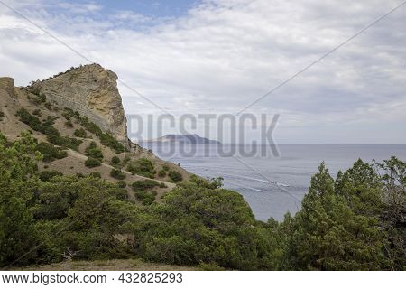 Black Sea Promenade With Mountains And Hills. Landscape Of Mountains And Sea.
