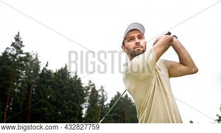 Young male playing golf on the field