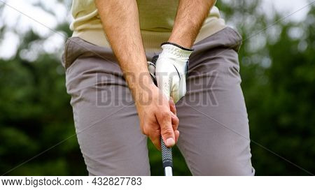 Young golfer hitting golf ball on a course close-up