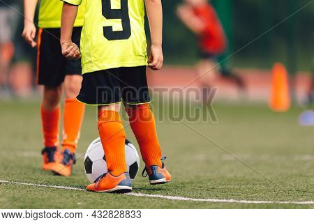 Sports Soccer Players On Training. Kids Kicking Soccer Balls On Practice Session. Kids Playing Socce