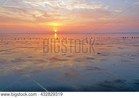Sunset at the Wadden Sea in the Netherlands