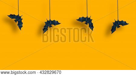 Horizontal Pattern. Black Bats In Row Are Suspended With Spread Wings On Yellow Orange Background. H