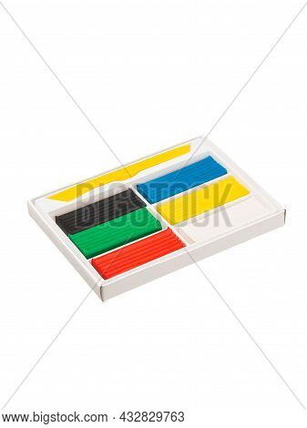 Plasticine Of Different Colors In A White Cardboard Box Without A Lid Is Isolated On A White Backgro