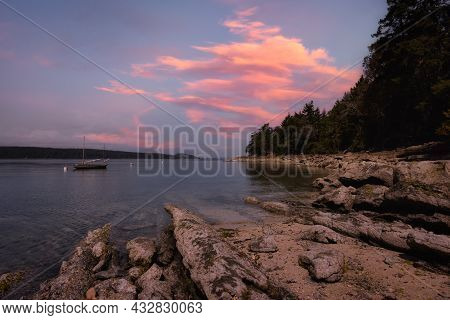 Rocky Shore With Canadian Nature Landscape On The Pacific Ocean West Coast. Twilight Sky Art Render.
