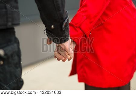 A Man And A Woman Hold Hands As A Sign Of Love And Support, Together And Forever - Hands Close-up. R