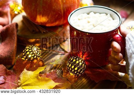 Red Mug Hot Chocolate With Marshmallows On Table With Maple Leaves, Garlands, Cinnamon Sticks. Autum