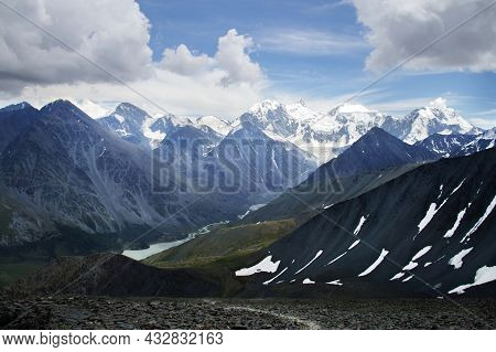 Altai Mountain Gorge And Belukha Mountain With Snow-capped Peaks. Ak-kem River Valley Aerial View, A