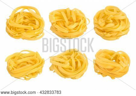 Raw Tagliatelle Pasta Isolated On White Background With Full Depth Of Field. Set Or Collection