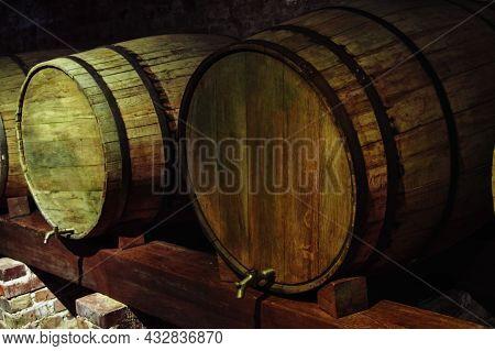 Old Barrels Of Wine In Dark Basement.
