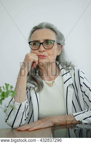 Closeup Portrait Of Angry Upset Senior Mature Businesswoman At The Office. Negative Emotion, Facial