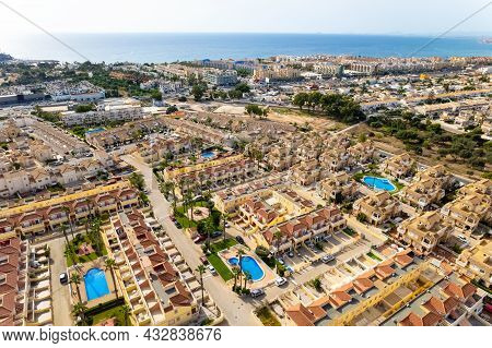 Aerial Drone Point Of View Cabo Roig Townscape On The Costa Blanca Of Spanish Tourist Resort, Blue W