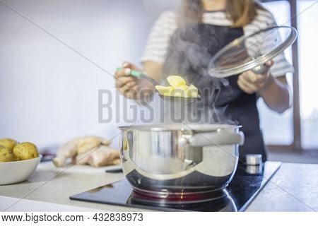 Young Woman Is Cooking In The Kitchen. Healthy Eating. Healthy Lifestyle. Cook At Home. Cooking Food
