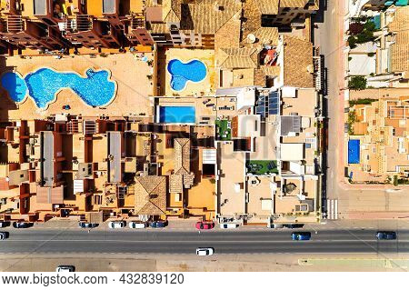 Directly Above Aerial View Residential Typical Houses With Swimming Pool And Town Road With Cars. Pr