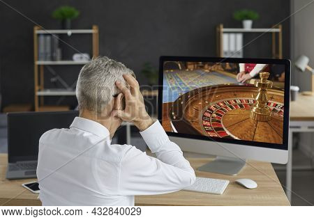 Unlucky Gambler Plays An Online Casino Game On His Computer And Loses All His Money