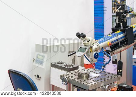High Technology And Precision Laser Welding Machine And Sample Workpiece On Work Table For Mold And
