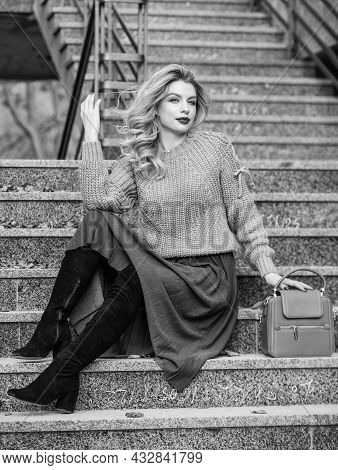 Fall Outfit Formula. Style Sweater And Skirt Combo For Fall. Woman Gorgeous Hairstyle Sit On Stairs