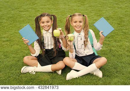 Fruit Of Knowledge. Happy Children Hold Apples On Green Grass. Vitamin Fruit. School Break. Snack Wi