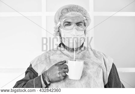 Personal Protective Equipment. Guy In Mask Drink Tea Coffee Using Straw. Infection Prevention And Co