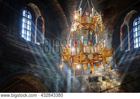 Rays Of Light In An Ancient Stone Church. The Suns Rays In Dark Stone Temple. Lighting Effects On Th