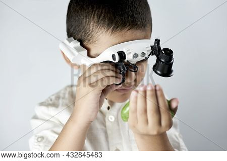 A Boy In Head Magnifying Glasses Headset Learning Incredible Chemistry Of Slimes. Tactile Play Or Se