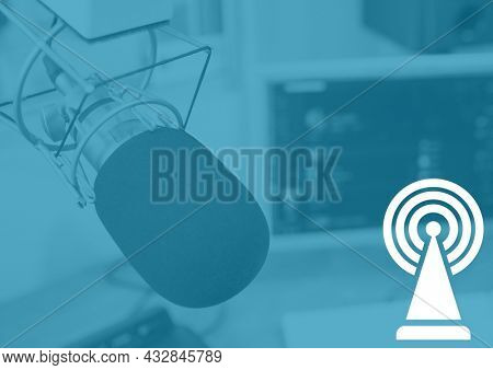 Composition of white broadcasting symbol and microphone in radio studio on blue background. radio communication concept, template with copy space digitally generated image.